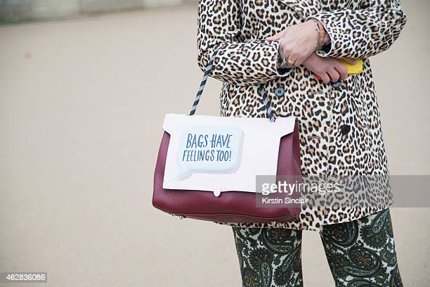 Founder of Please magazine Olivia Dacosta wears a Carven coat Zara trousers and Anya Hindmarch pants on day 3 of Paris Haute Couture Fashion Week...