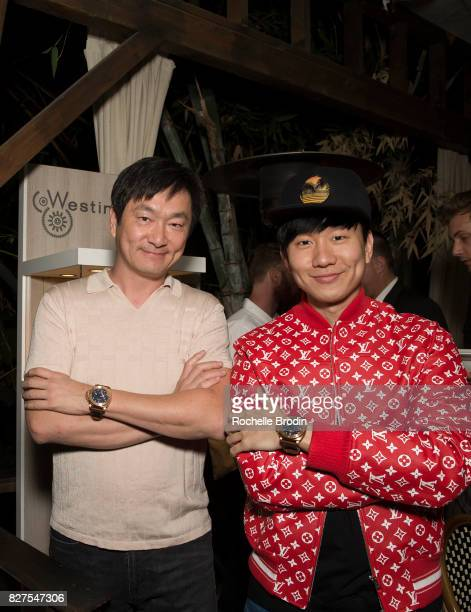 Founder of Purist Group Sean Lee and Singer JJ Lin pose with their own Westime watch at the Haute Living Celebrates Kate Mara with Westime event on...