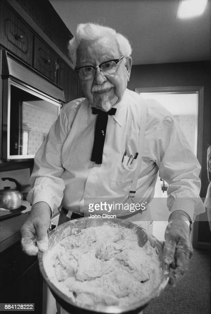 Founder of restaurant chain Kentucky Fried Chicken Colonel Harland David Sanders holding a bowl with his fried chicken batter Kentucky September 1974