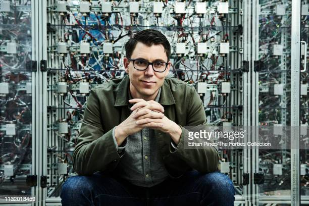 Founder of Rivian Automotive RJ Scaringe is photographed for Forbes Magazine on January 20 2019 in Irvine California Scaringe in front of cabinets...