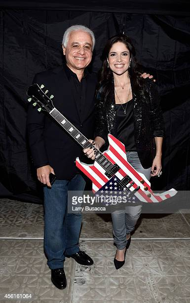 Founder of Rock in Rio Roberto Medina and vice president of Rock in Rio Roberta Medina pose during the Rock In Rio USA event in Times Square on...