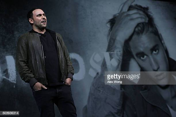 Founder of SB Projects Scooter Braun speaks as a photo of singer Justin Bieber is seen in the background during a keynote at CES 2016 at the Las...