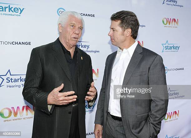 Founder of Starkey Hearing Foundation Bill Austin and Doug Pitt attend the premiere of Operation Change at Paramount Studios on June 18 2014 in Los...