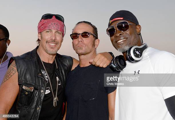 Founder of The Heroes Project Tim Medvetz Owner Chrome Hearts Richard Stark and Djimon Hounsou attend Cycle For Heroes at The Santa Monica Pier to...