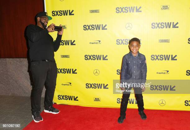 Founder of the Warriors Football program Luther Campbell takes of photo of his son Blake Campbell at the Starz panel for 'Warriors of Liberty City'...