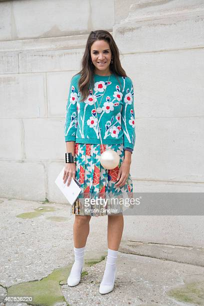 Founder of The Webster and fashion buyer Laure Heriard Dubreuil wears Chanel bag cuff skirt and sweater on day 3 of Paris Haute Couture Fashion Week...
