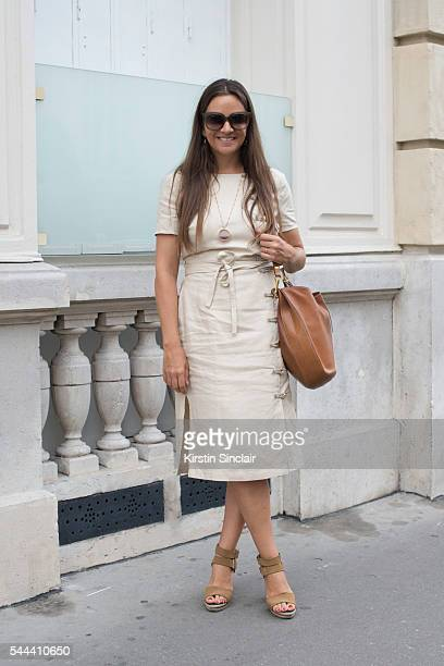 Founder of the Webster boutique Laure Heriard Dubreuil wears an Altuzarra dress Celine bag and sunglasses and Pierre Hardy shoes on day 3 of Paris...