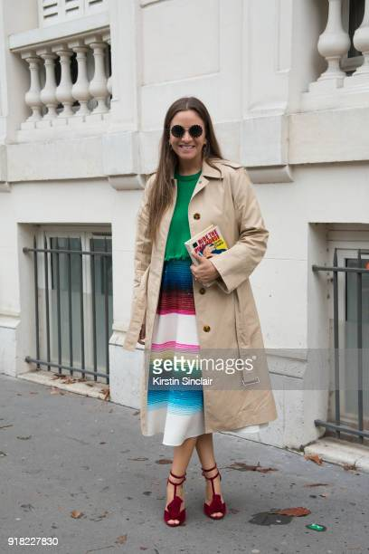 Founder of The Webster store and fashion buyer Laure Heriard Dubreuil wears a Celine coat Valentino dress and sunglasses and Charlotte Olympia bag...
