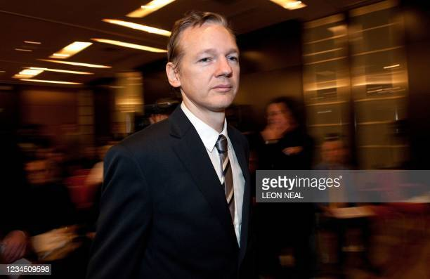 Founder of the Wikileaks website Julian Assange arrives for a press conference on October 23, 2010 during a press conference at the Park Plaza hotel...
