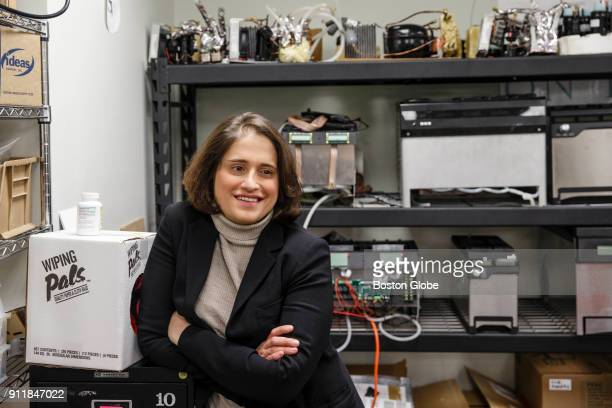 Founder Robin Liss poses for a portrait with prototypes of the Suvie a sous vide cooking device at the company's office in Cambridge MA on Jan 23...