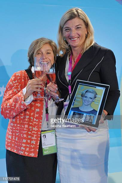 DLD founder Steffi Czerny and Dorothee Ritz of Microsoft celebrate the launch of GLO online magazine during the Digital Life Design women conference...