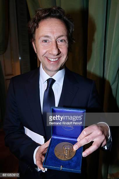Founder Stephane Bern showing the Prize from his effigy attend Stephane Bern's Foundation for 'L'Histoire et le Patrimoine Institut de France'...