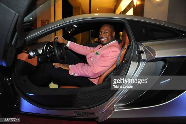 Founder Vernon Davis arrives in the MclarenMP412C to the opening of Art Gallery 85 In Santana Row To Help Raise Money For Intercity Arts Foundation...