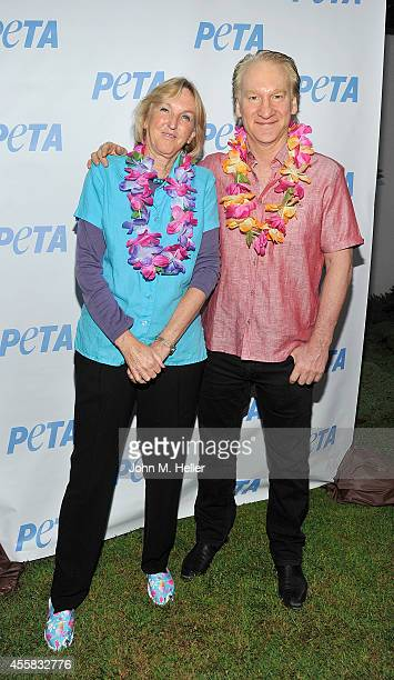 Founder/President of PETA Ingrid Newkirk and actor/comedian Bill Mahr attend PETA's Vegan Luau at Sam Simon's home on September 20 2014 in Pacific...