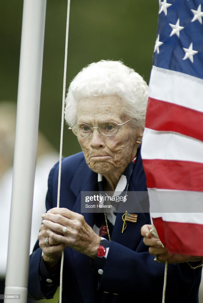 LPGA founding member Patty Berg raises the US flag during opening ceremonies of the 2002 Solheim Cup matches between USA and Europe held at the Interlachen Golf Club on September 19, 2002 in Edina, Minnesota.