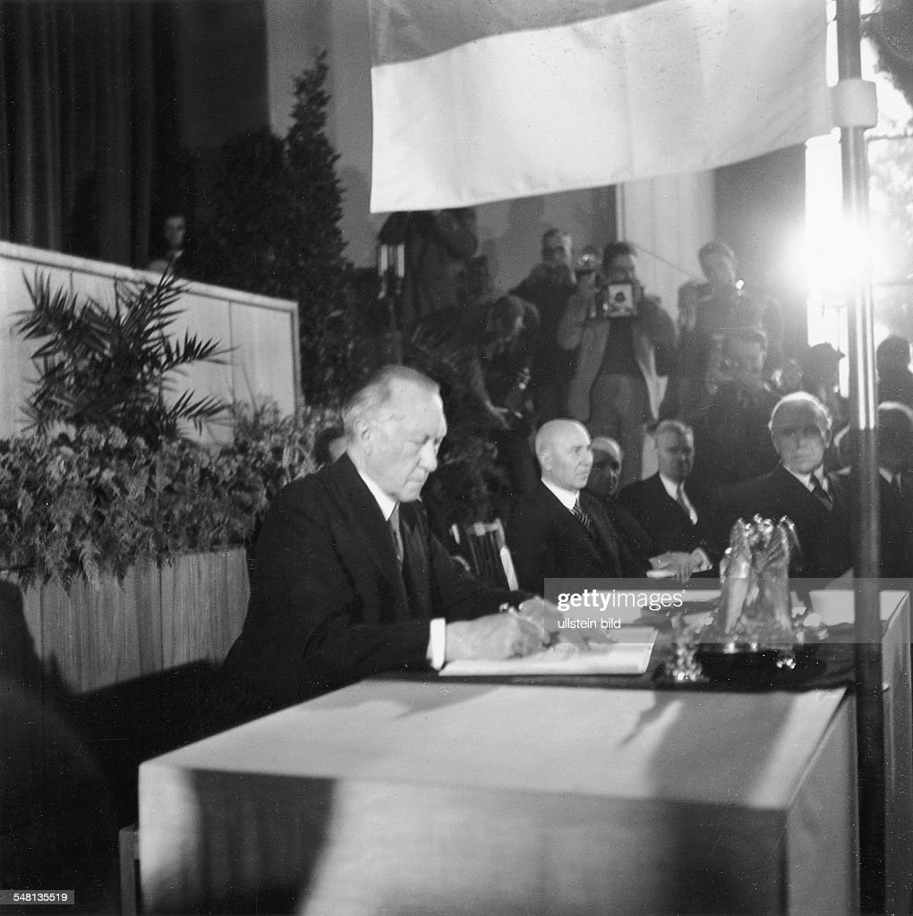Founding of the Federal Republic of Germany: Signing of the Basic Law (the Constitution) for the Federal Republic of Germany by the Chairman of the Parliamentary Council, Konrad Adenauer, at the Pedagogic Academy in Bonn - 23.05.1949 Photograph: Erna : News Photo