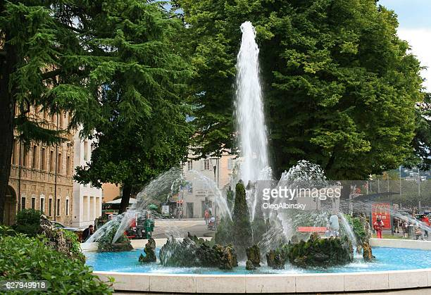 Fountain and Town Square with Green Trees, Lugano, Switzerland.