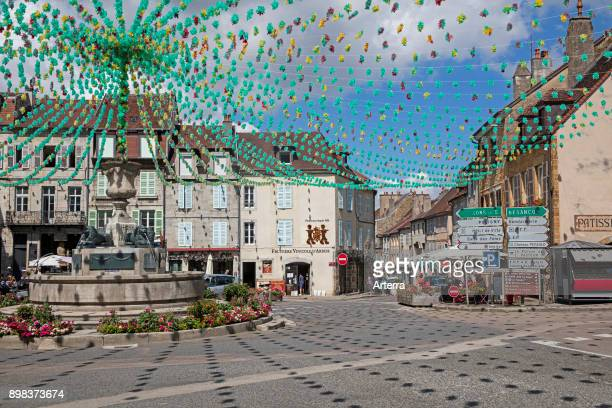 Fountain at decorated Liberty Square / place de la Liberte in the town Arbois commune in the Jura department FrancheComte LonsleSaunier France