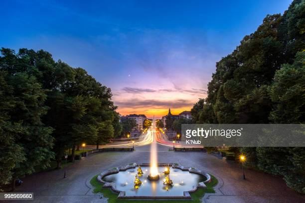 Fountain at Friedensengel, where is the famous landmark for sunset time with transportation on avenue in Munich, Germany, Europe