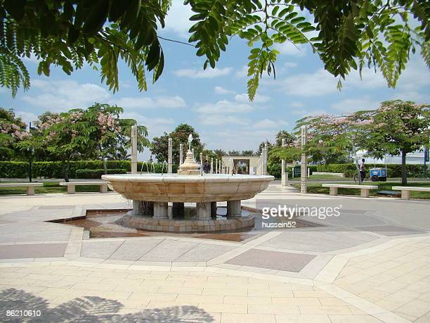 fountain blue sky green tree, azhar park - hussein52 stock photos and pictures