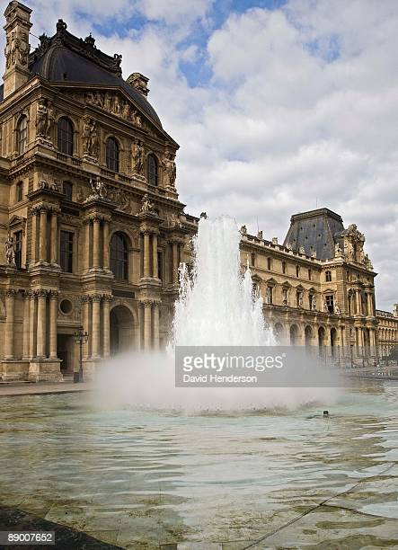 Fountain by building, Louvre courtyard, Paris France