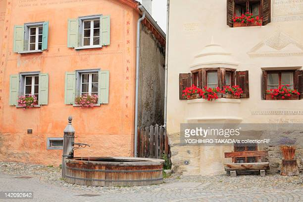 fountain by houses - guarda switzerland stock pictures, royalty-free photos & images