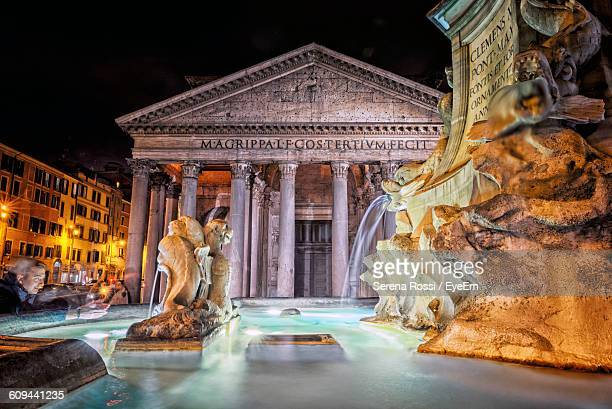 fountain by pantheon at night - pantheon rome stock photos and pictures