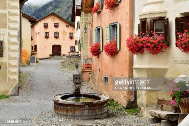 Fountain in a street of the village, Guarda, Scuol, Engadin, Canton of Graubunden, Switzerland.