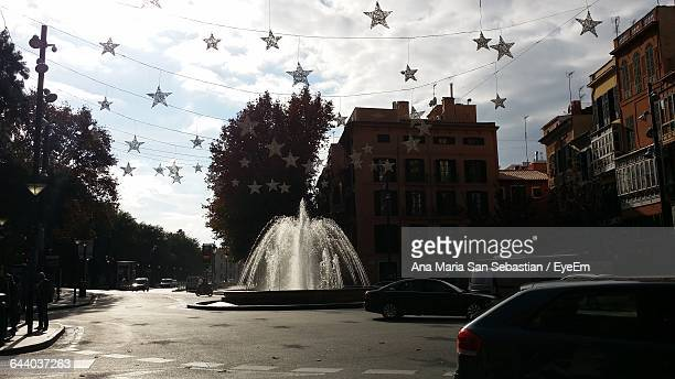 Fountain In City With Star Shaped Decoration During Christmas