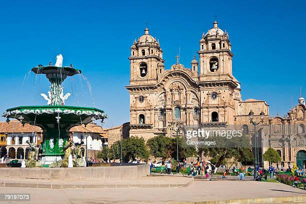 Fountain in front of a church, La Compania, Plaza-De-Armas, Cuzco, Peru