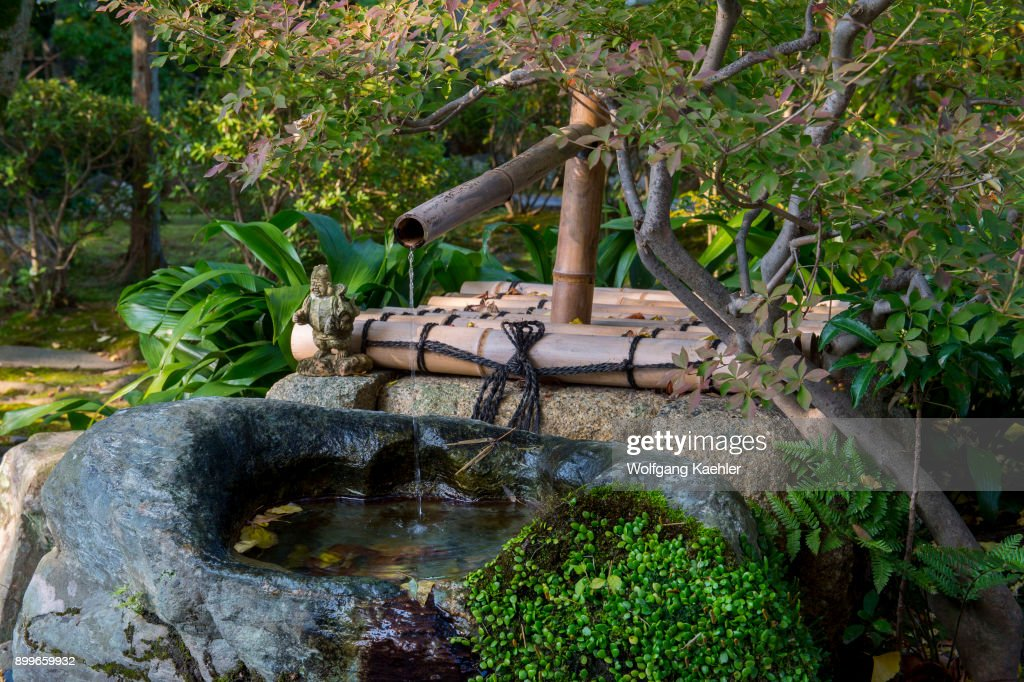 A Fountain In The Japanese Garden Of A Restaurant In Kyoto, Japan.