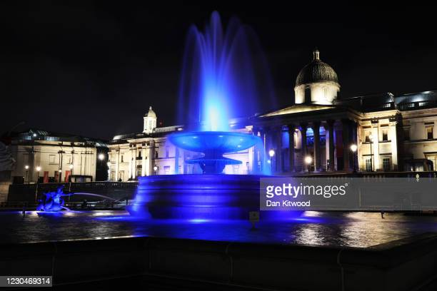 Fountain in Trafalgar Square is lit up blue in support of the NHS on January 7, 2021 in London, England. In a renewed gesture of thanks to the NHS...