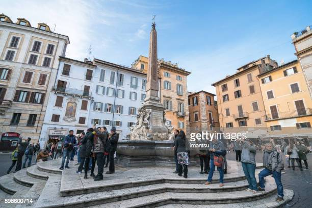 fountain next to the pantheon in rome, italy - pantheon rome stock photos and pictures