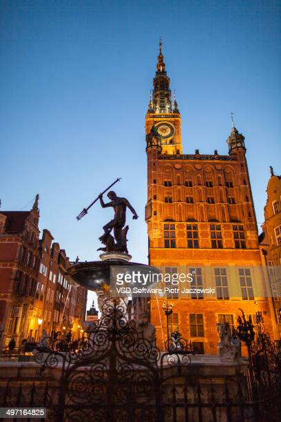 CONTENT] Fountain of Neptune and Town Hall on Long Market street in Gdansk old town during late evening