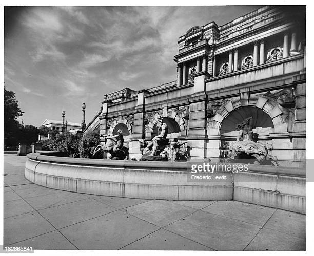 Fountain Of Neptune at Library Of Congress with roof of the Supreme Court to the left In Washington, DC, 1955.