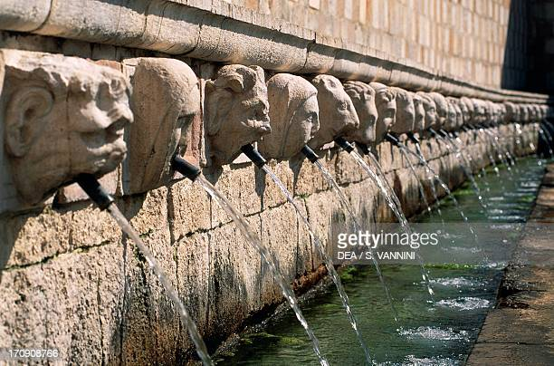 Fountain of the 99 Spouts , L'Aquila, Abruzzo, Italy. Detail of the masks.