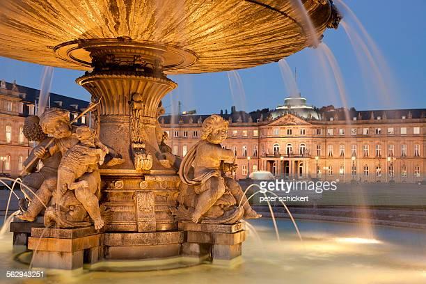 Fountain on Schlossplatz and New Palace at night, Stuttgart, Baden-Wurttemberg, Germany