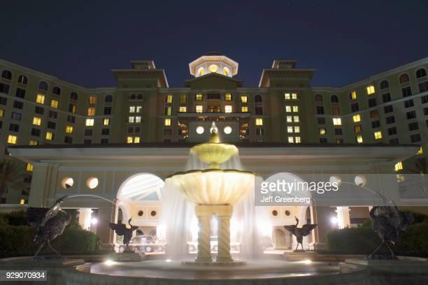 A fountain outside Rosen Shingle Creek Hotel at night