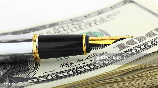 Fountain pen and dollars