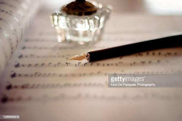 Fountain pen atop sheet music
