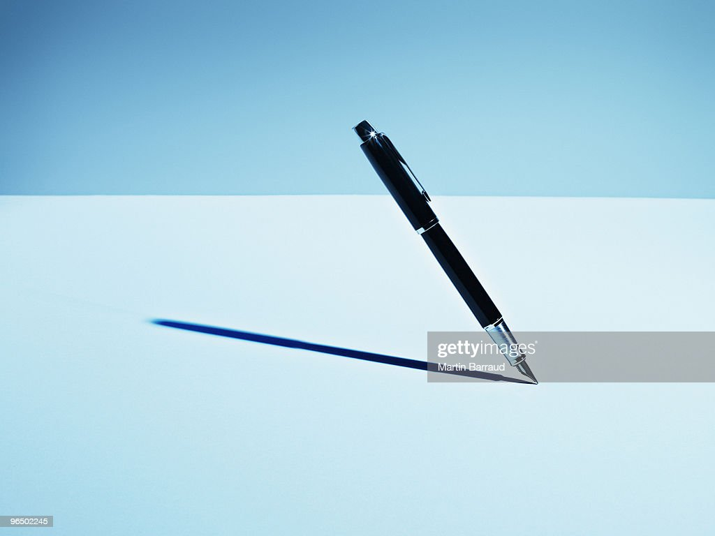 Fountain pen casting shadow : Stock Photo