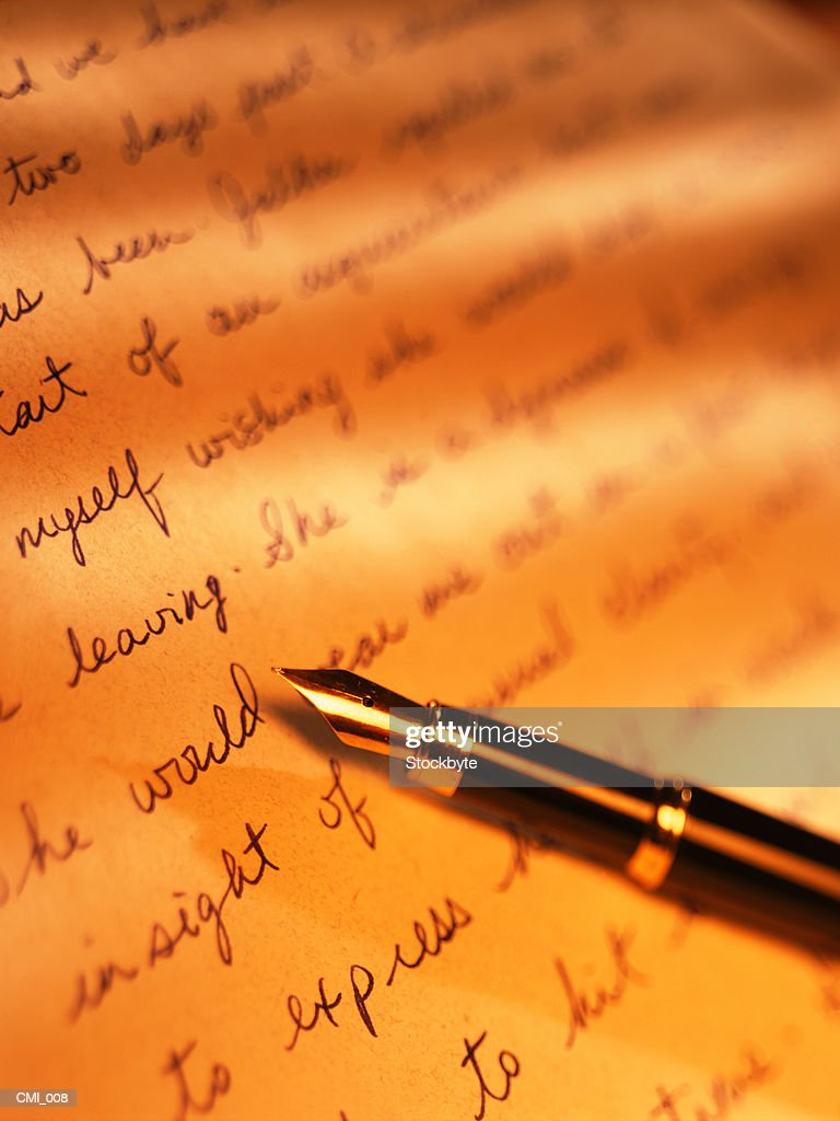 Fountain pen lying on sheet of  paper : Stock Photo