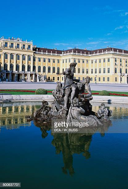 Fountain with statue group representing Galicia Lodomeria and Transylvania with Schonbrunn Castle in the background Vienna Austria 18th century