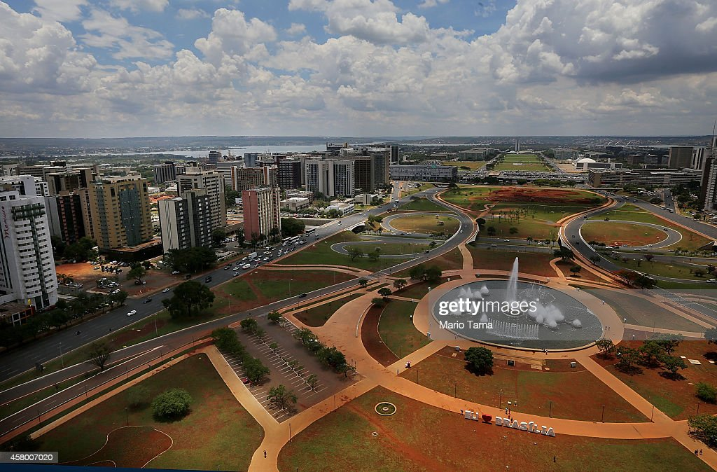 Fountains spray along the Monumental Axis on October 28, 2014 in Brasilia, Brazil. Brazil's left-wing President Dilma Rousseff was narrowly re-elected October 26 and will serve another four years in Brazil's unique planned capital city. The modernist city was founded in 1960 and replaced Rio de Janeiro as the federal capital of Brazil. The city was designed by urban planner Lucio Costa and architect Oscar Niemeyer and is now a UNESCO World Heritage site.
