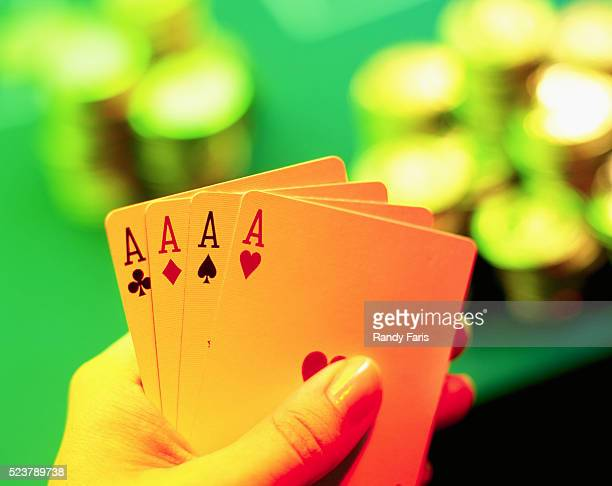 Four Aces in Poker Player's Hand