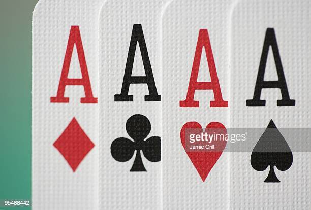 four aces - hand of cards stock photos and pictures