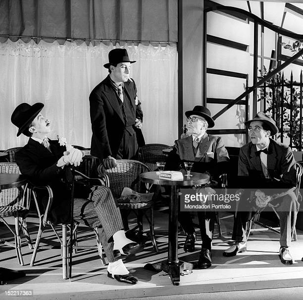 Four actors are chatting at a table of a café Piccolo Teatro Milan February 24 1954