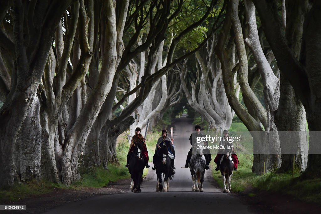 Four actors on horseback dressed in Game of Thrones related costumes carry the Queen's Baton as they make their way way along the Dark Hedges on August 29, 2017 in Antrim, Northern Ireland. The Dark Hedges near Stranocum in County Antrim featured as the King's Road in season two of Game of Thrones and has become a tourist mecca for fans of the television series along with other filming locations in the province. The Queen's Baton Relay is currently on a tour of the United Kingdom as it makes its way around Europe in preparation for the 2018 Commonwealth Games in Australia.