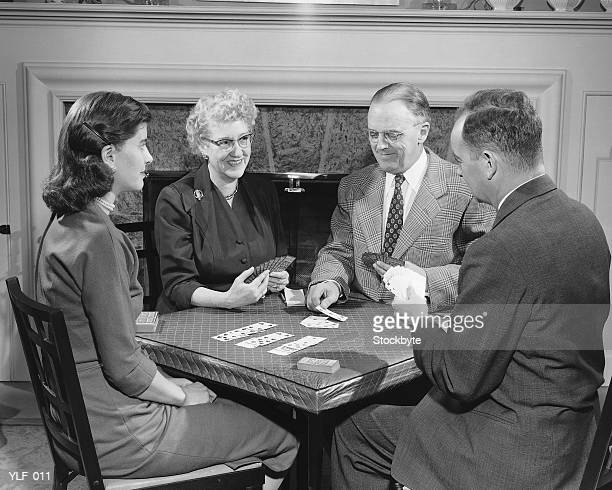 Four adults playing cards