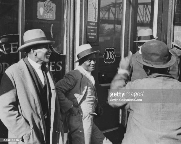 Four African American men talking at religious gathering Nashville Tennessee USA 1935 From the New York Public Library